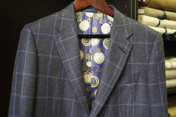 Grey suit with a watch design suit lining