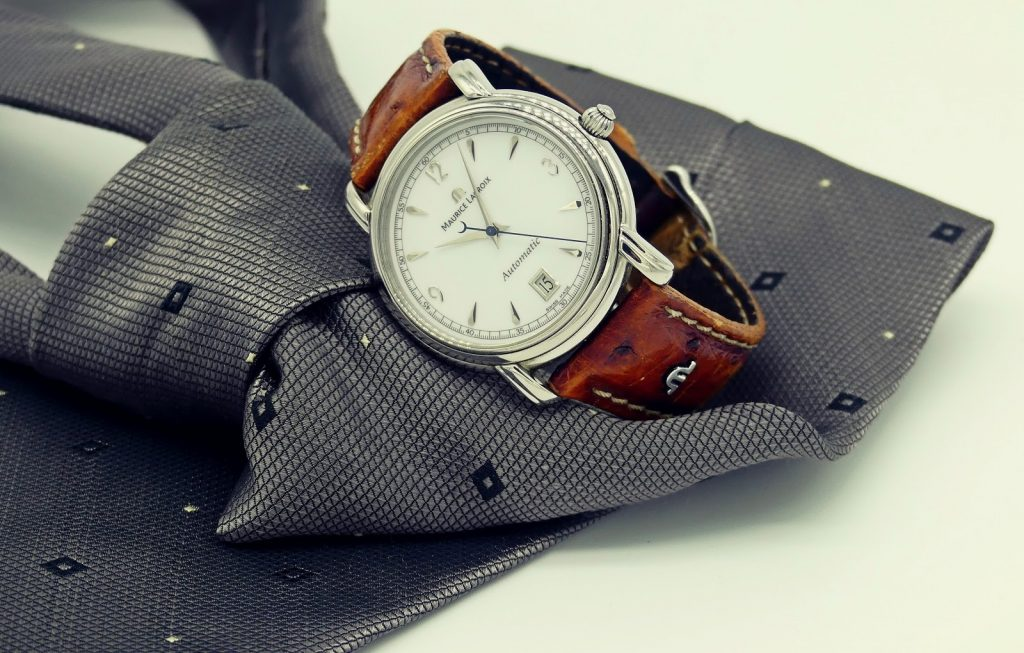 A grey necktie and a watch