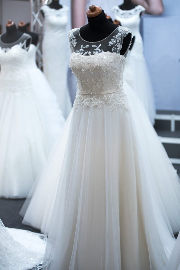 White wedding dress on stand